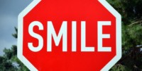 Smile road sign